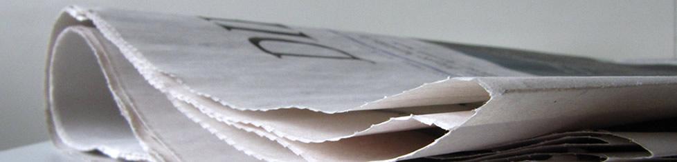 Foto einer gefalteten Zeitung, die den Pressebereich von Traum-Ferienwohnungen.de symbolisiert.
